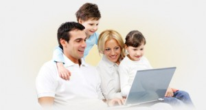 Photo of family gawking at a laptop