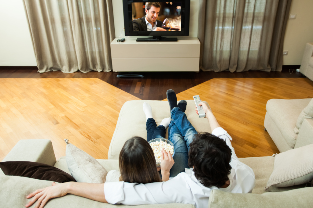 Photo of a couple watching tv